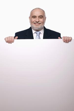 Businessman holding a placard photo