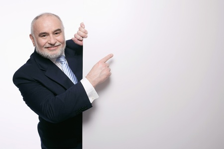 Businessman pointing at placard photo