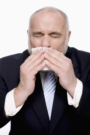 Businessman about to sneeze photo