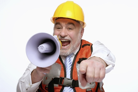 Man with hardhat pointing while shouting into megaphone Stock Photo - 9956790