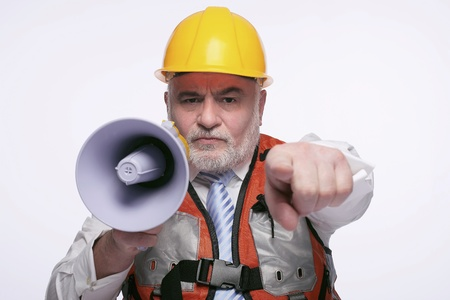Man with hardhat pointing while shouting into megaphone photo