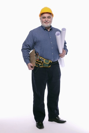 Man with hardhat holding clipboard and rolls of blueprint photo