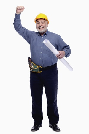 Man raising his arm while holding a roll of blueprint  photo