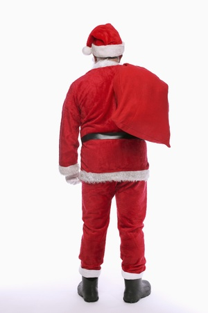 Santa claus carrying a sack Stock Photo - 9956776