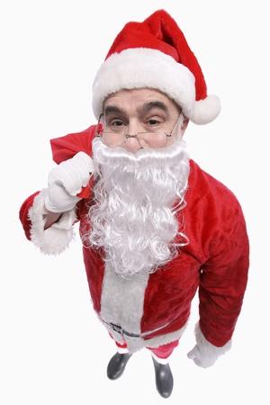 Santa claus carrying sack photo