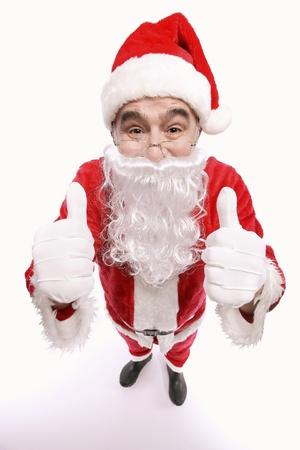 Santa claus giving thumbs up photo