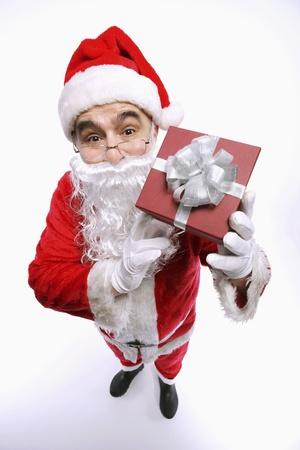 Santa claus holding present photo