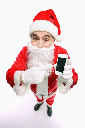 Santa claus pointing at mobile phone photo