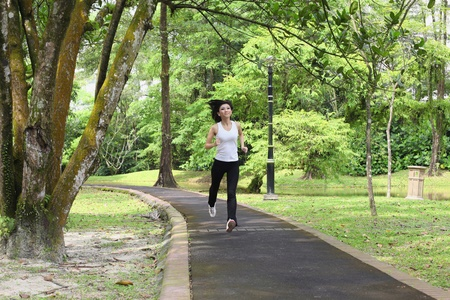 Woman jogging in the park photo
