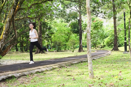 Woman jogging in the park Stock Photo - 9957909