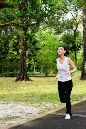 Woman jogging with MP3 player