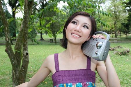 Woman listening to radio photo