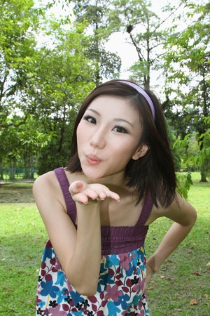 Woman blowing kiss Stock Photo - 9957877