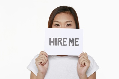 Woman holding placard with text 'hire me' Stock Photo - 9957306