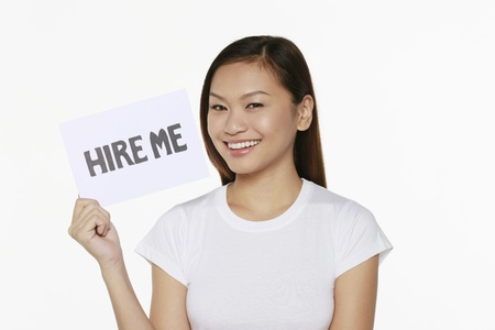 Woman holding placard with text hire me photo