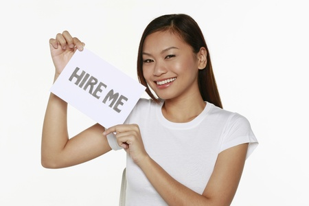 Woman holding placard with text 'hire me' Stock Photo - 9957457