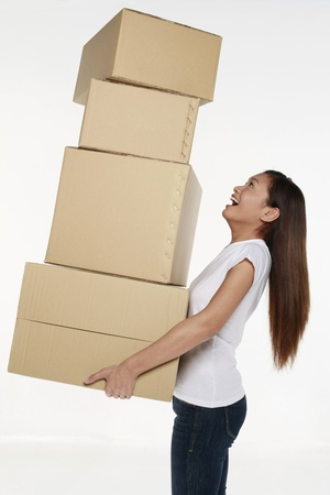 heavy risk: Woman carrying a stack of boxes