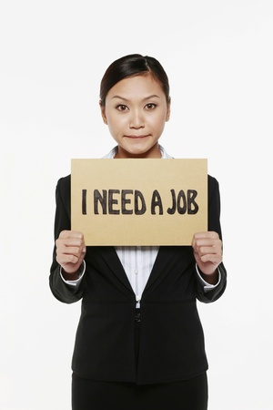 Woman holding placard with text I need a job photo