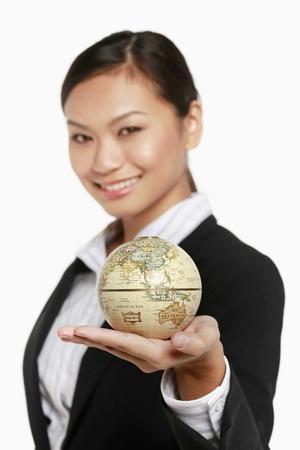 Businesswoman holding globe Stock Photo - 9957102