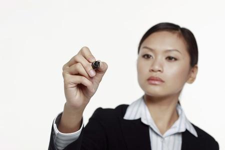 marker pen: Businesswoman writing with marker pen