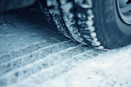 winter tires: Car and tire track in the snow