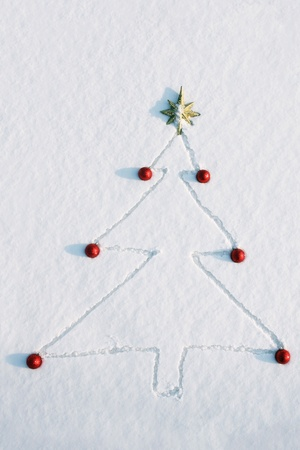 no idea: Christmas tree drawn and decorated in snow Stock Photo