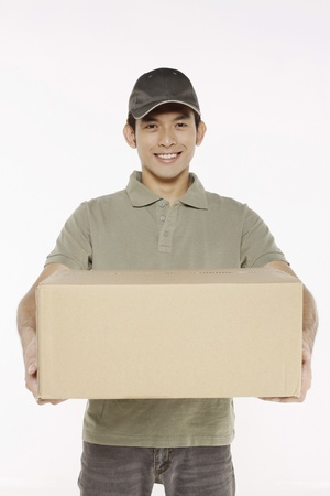 man carrying box: Man holding a package