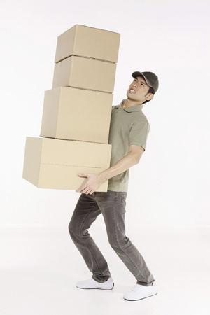 man carrying box: Man carrying a stack of packages Stock Photo