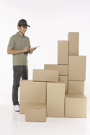 Man checking the packages Stock Photo - 10057687