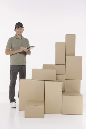 Man checking the packages Standard-Bild