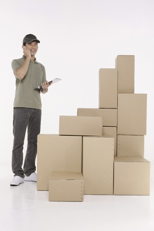 Man talking on the phone while checking the packages photo