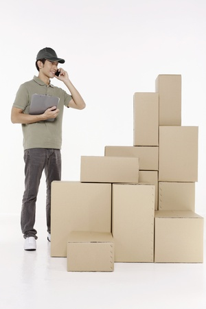 Man talking on the phone while checking the packages Stock Photo - 10057684