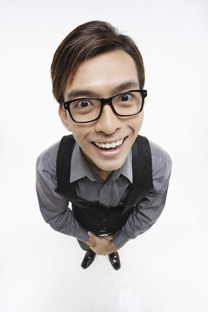 high angle shot: Businessman with glasses smiling