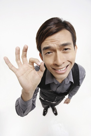 Businessman showing OK sign Stock Photo - 10057691