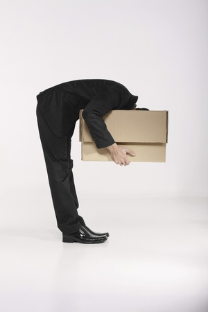 unpacking: Businessman looking into a box Stock Photo