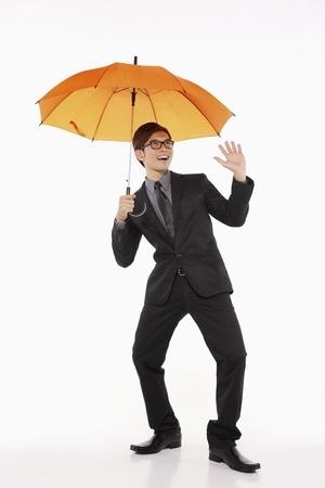 Businessman with an umbrella Stock Photo - 10057667