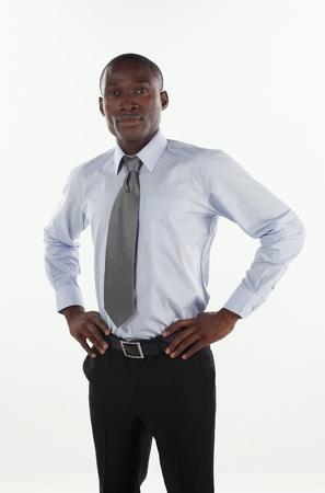 mani sui fianchi: Uomo d'affari con le mani sui fianchi