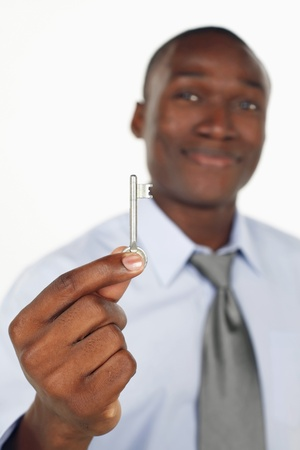 ownership and control: Businessman holding a key