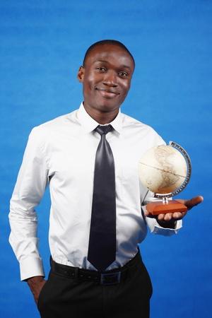 Businessman holding globe photo