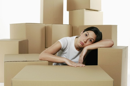 Woman taking a break from unpacking photo