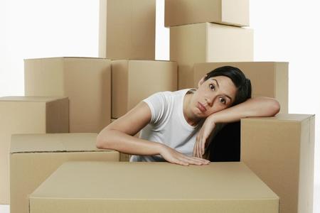 puffed cheeks: Woman taking a break from unpacking