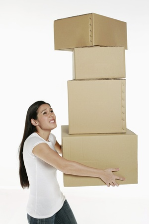 Woman carrying stack of boxes photo