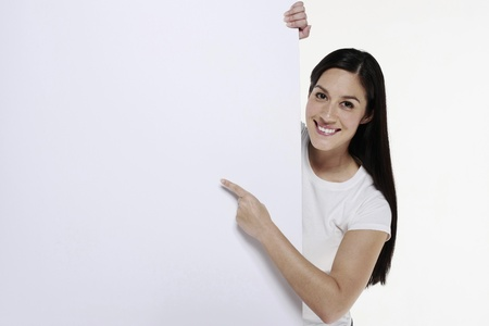 Woman pointing at white placard