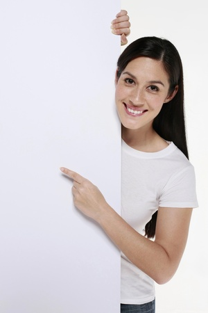 woman pointing up: Woman pointing at white placard
