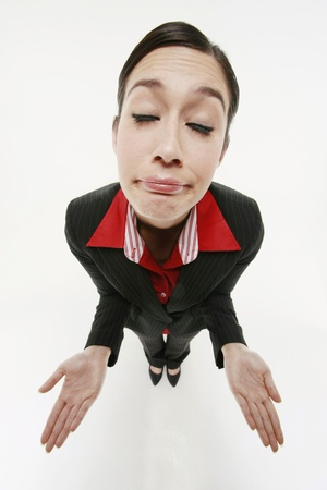 shrugging: Businesswoman shrugging Stock Photo