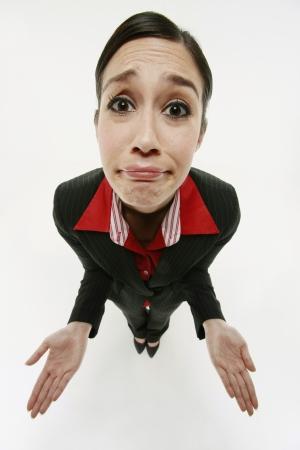 ignorance: Businesswoman shrugging Stock Photo