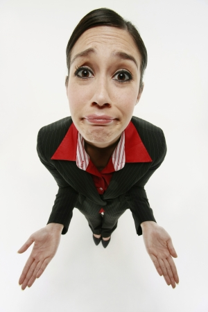 Businesswoman shrugging Standard-Bild