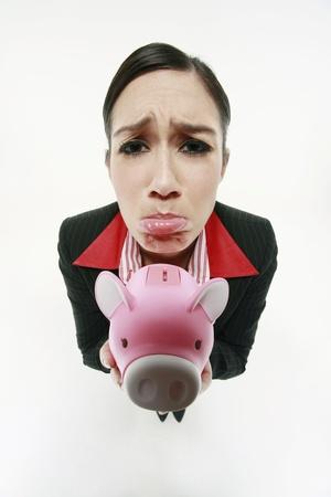 Businesswoman holding piggy bank  photo