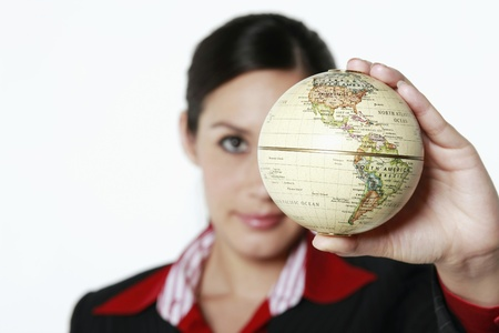 corporate responsibility: Businesswoman holding globe