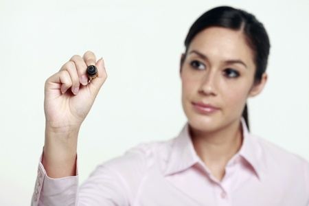 marker pen: Businesswoman holding marker pen and writing
